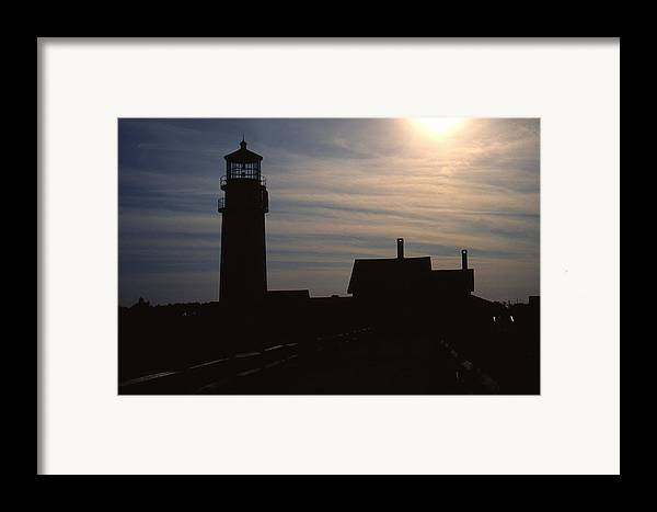 Ocean Framed Print featuring the photograph Truro Lighthouse In Silhouette by Roger Soule