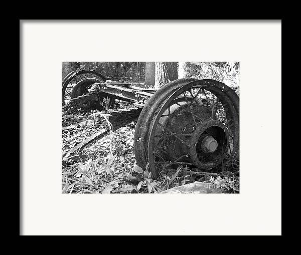 Wheel Framed Print featuring the photograph Turning by Stephanie Richards