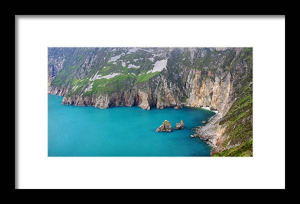 Slieve League Framed Print featuring the photograph turquoise sea at Slieve League cliffs Ireland by Pierre Leclerc Photography