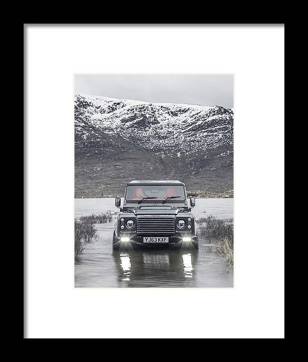 65f63141fc Land Rover Framed Print featuring the photograph Twisted Land Rover Defender  by George Williams