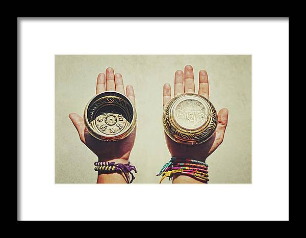Aged Framed Print featuring the photograph Two Hands Holding And Showing Both Sides Of Decorated Tibetan Singing Bowls by Srdjan Kirtic