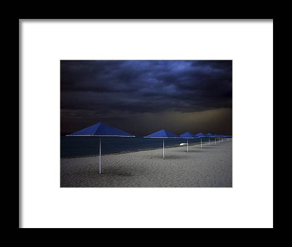 Fantastic Framed Print featuring the photograph Umbrella Blues by Aydin Aksoy