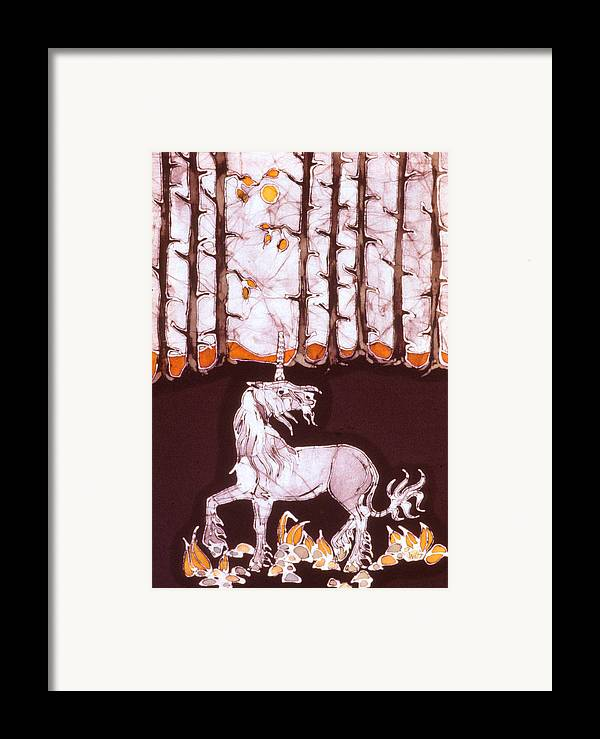 Unicorn Framed Print featuring the tapestry - textile Unicorn Below Trees In Autumn by Carol Law Conklin