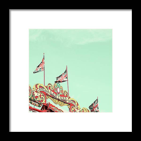 Flags Framed Print featuring the photograph Union Jacks by Debra Cox