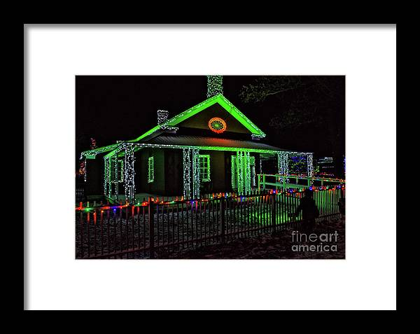 framed print featuring the photograph upper canada village dressmakers shop christmas lights by robert