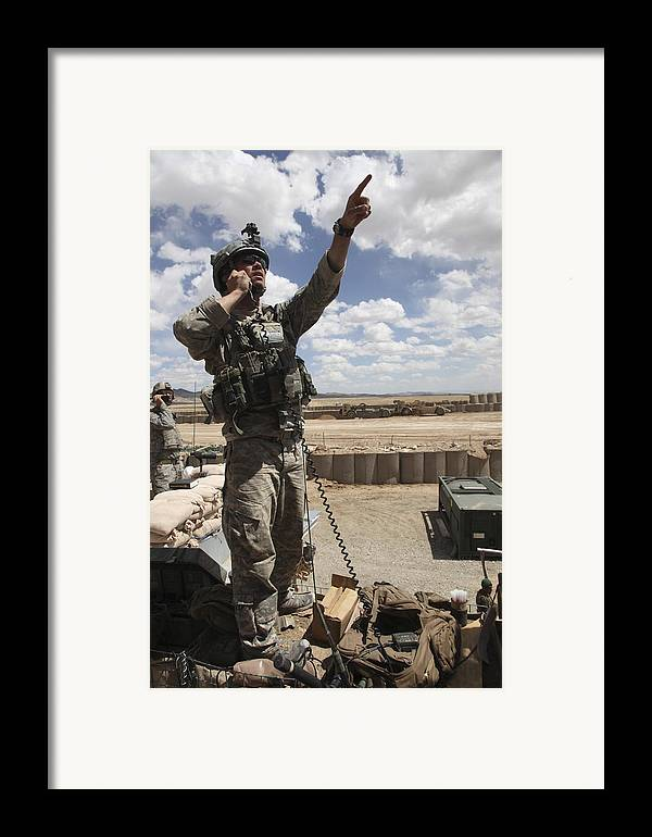 Looking Up Framed Print featuring the photograph U.s. Air Force Member Calls For Air by Stocktrek Images