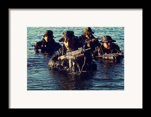History Framed Print featuring the photograph Us Navy Seal Team Emerges From Water by Everett
