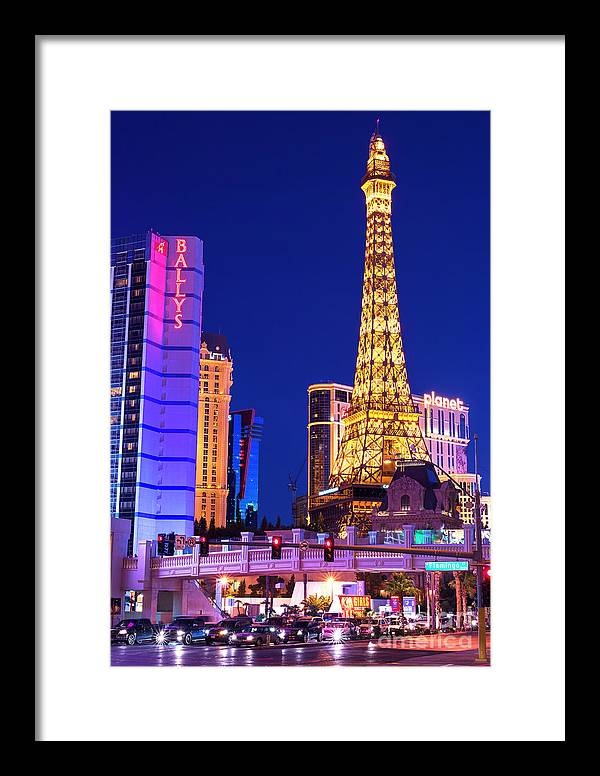 The Strip At Night Framed Print featuring the photograph Vegas Strip At Night by John Rizzuto