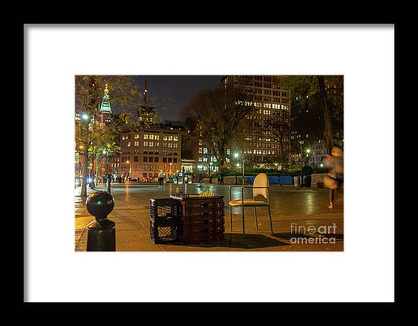 Manhattan Framed Print featuring the photograph View Of Chess Board In The Middle Of Busy Sidewalk At Night by PorqueNo Studios