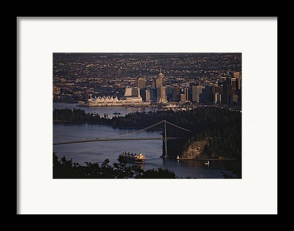 North America Framed Print featuring the photograph View Of Vancouver, British Columbia by Annie Griffiths