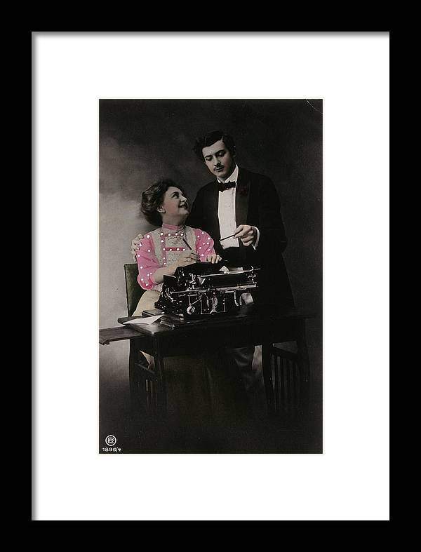 Adults Framed Print featuring the photograph Vintage Young Man And Woman Using by Gillham Studios