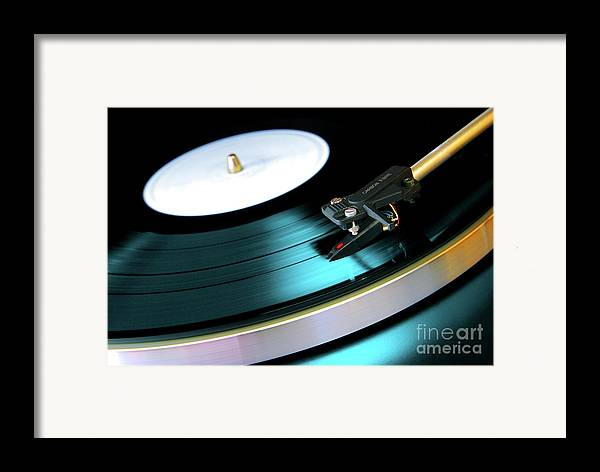 Abstract Framed Print featuring the photograph Vinyl Record by Carlos Caetano