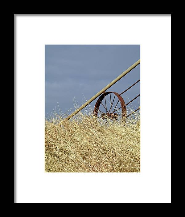 Wagon Wheel Framed Print featuring the photograph Wagon Wheel Fence by Gale Cochran-Smith