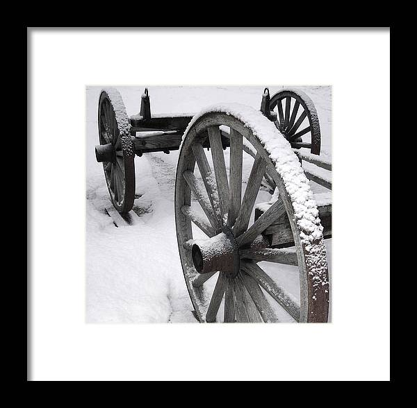 Linda Drown Framed Print featuring the photograph Wagon Wheels In Snow by Linda Drown