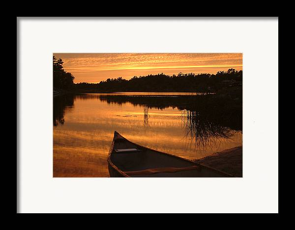 Canoe Framed Print featuring the photograph Waiting For Me by Linda McRae