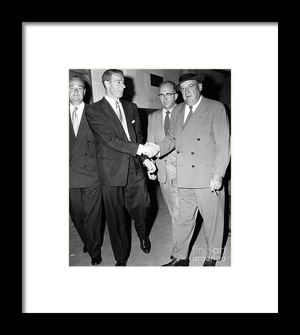 New York Post Prints; Baseball; Joe Dimaggio; Walter O'malley; Anthony Calvacca; Brooklyn Dodgers; Yankees; 1956 World Series; Game 7 Framed Print featuring the photograph Walter O'malley Is Consoled By Joe Dimaggio After The Dodgers Loss To The Yankees 1956 World Series. by Anthony Calvacca