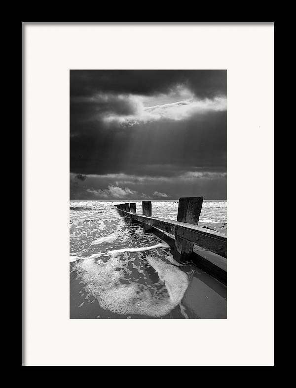 Groyne Framed Print featuring the photograph Wave Defenses by Meirion Matthias