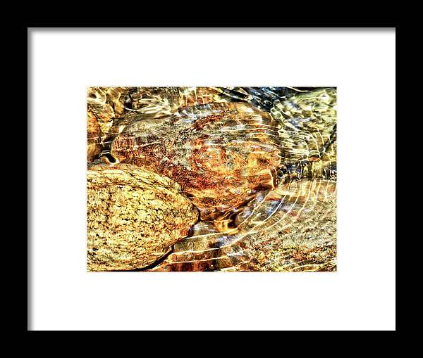 Waves Framed Print featuring the photograph Wavy Water on Colorful Rocks by Kirsten Giving