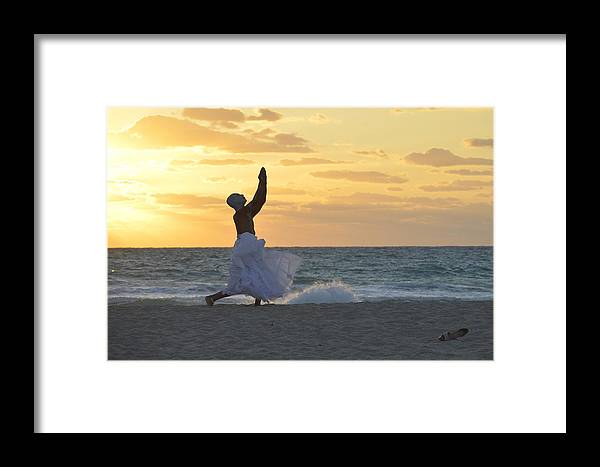 Javier Cordoba Framed Print featuring the photograph What Saves Our Life by Lenin Caraballo