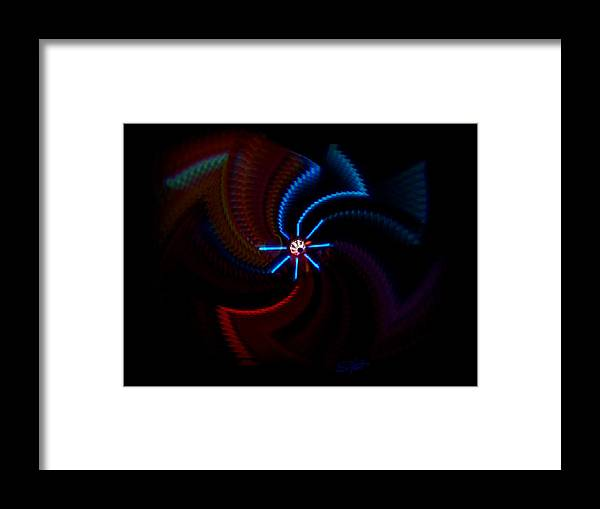Chaos Framed Print featuring the photograph Wheel by Charles Stuart