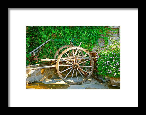Wooden Wheel Framed Print featuring the photograph Wheel Of Happiness by Dorota Nowak