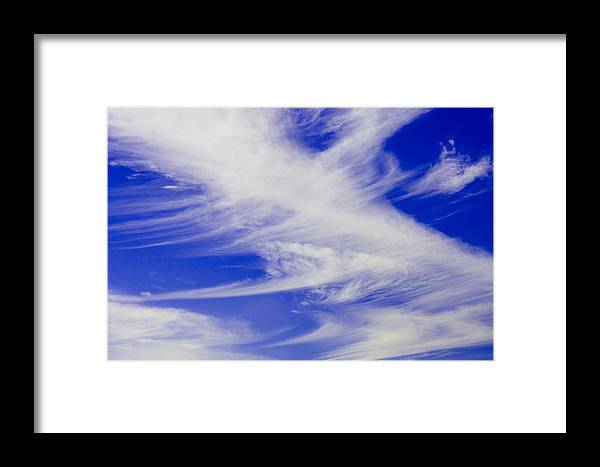 Framed Print featuring the photograph Whispy Clouds by Brian Jordan