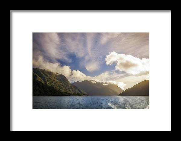 Doubtful Sound Framed Print featuring the photograph White Dragon Cloud In The Sky At Lake Manapouri by Daniela Constantinescu