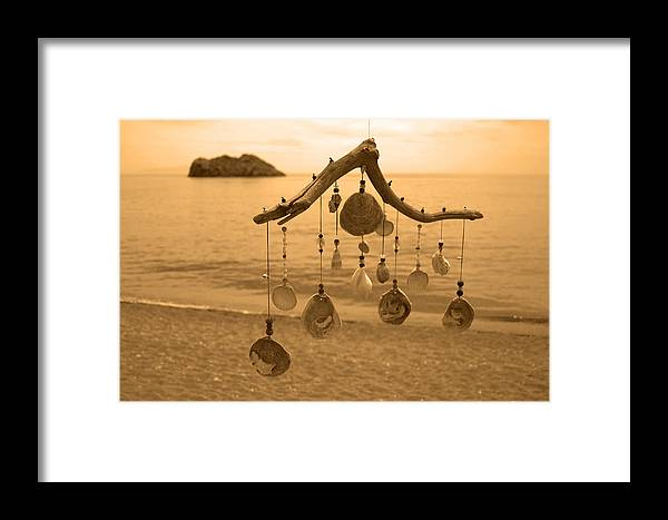 Wind Chime Framed Print featuring the photograph Wind Chime by Daren Griffin