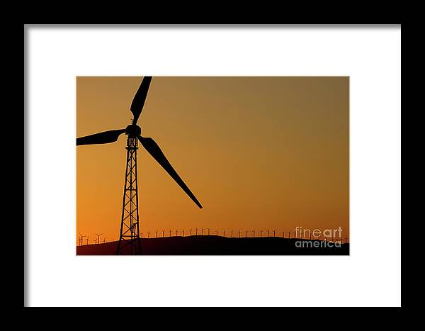 Alternative Energy Framed Print featuring the photograph Wind Turbine On A Ridge At Sunset by Sami Sarkis