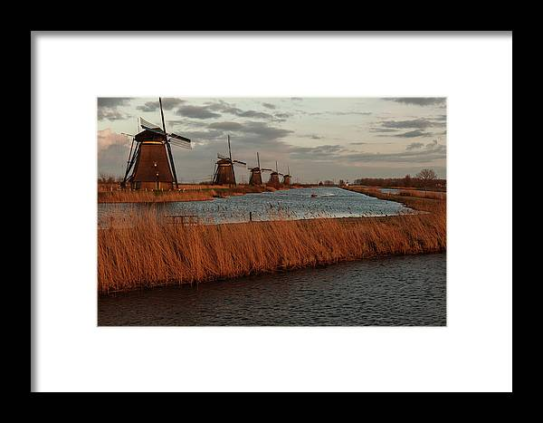Framed Print featuring the photograph Windmills In The Evening Sun by Manuel Posch