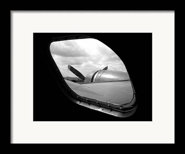 Airplane Framed Print featuring the photograph Wing And Window by Dan Holm