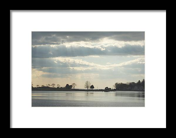 Clouds Framed Print featuring the photograph Winter's Light At South Harbor by Margie Avellino