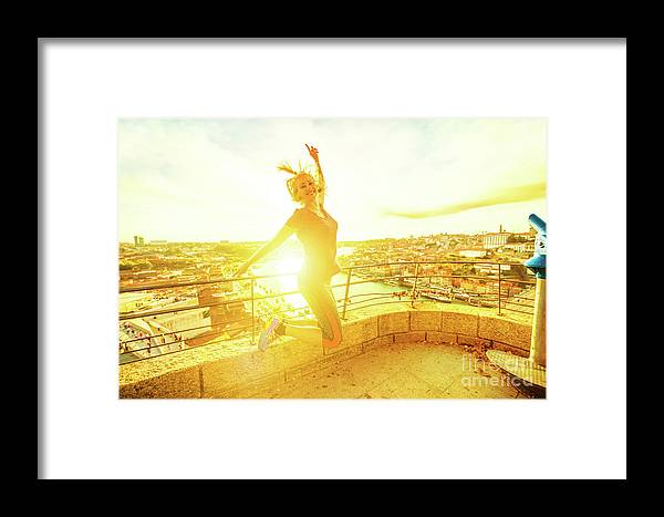 Oporto Framed Print featuring the photograph Woman Jumping At Oporto by Benny Marty