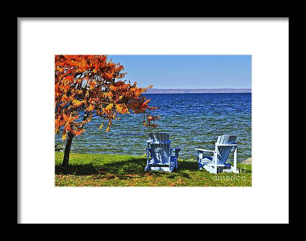 Lake Framed Print featuring the photograph Wooden Chairs On Autumn Lake by Elena Elisseeva