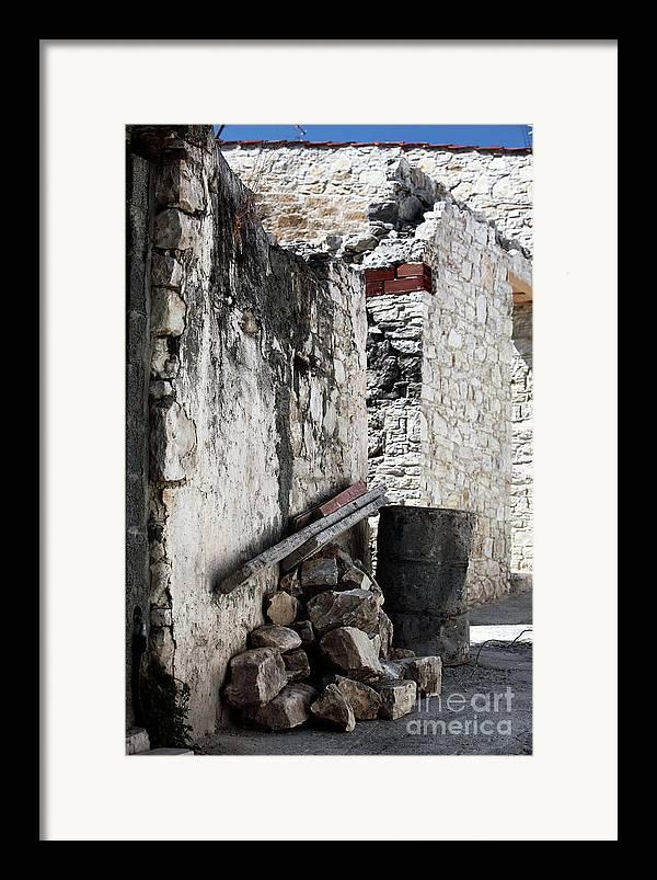Working In Cyprus Framed Print featuring the photograph Working In Cyprus by John Rizzuto