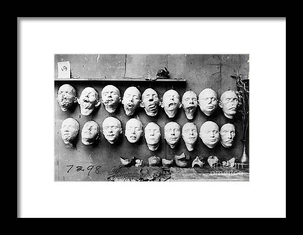 1918 Framed Print featuring the photograph World War I Masks, 1918 - To License For Professional Use Visit Granger.com by Granger