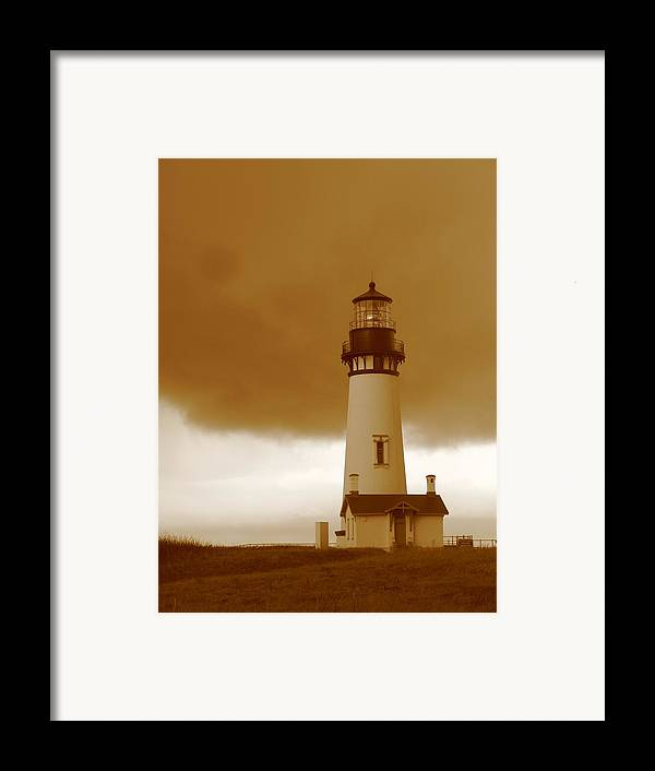 Lighthouse Framed Print featuring the photograph Yaquina Head Lighthouse Sepia by Juli House