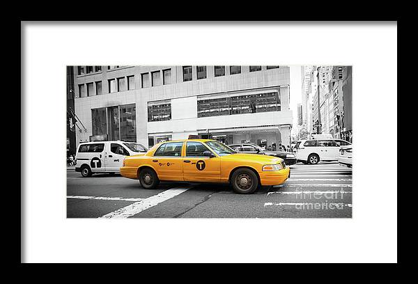 Street Framed Print featuring the photograph Yellow Cab In Manhattan With Black And White Background by Antonio Gravante