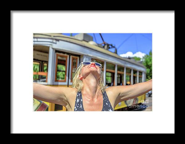 Lisbon Framed Print featuring the photograph Yellow Tram Enjoying by Benny Marty