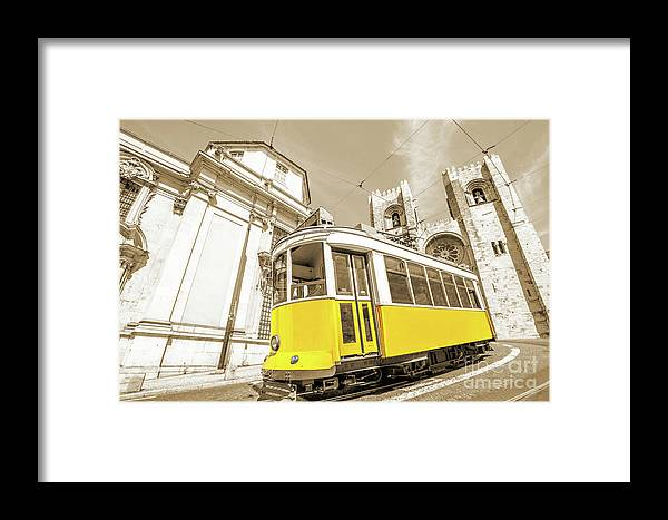 Lisbon Framed Print featuring the photograph yellow tram Lisbon by Benny Marty