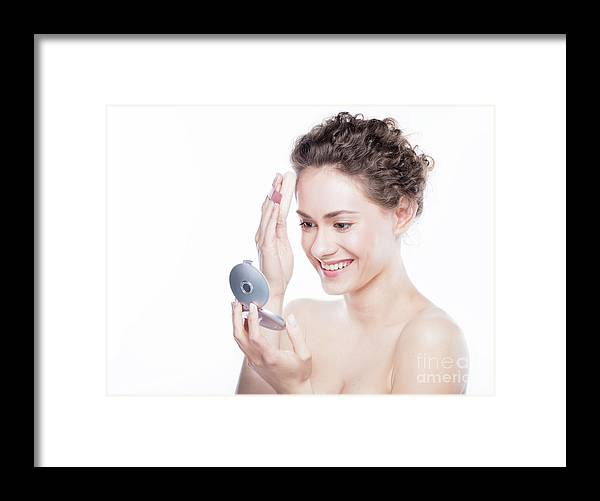 Woman Framed Print featuring the photograph Young Beautiful Woman Applying Powder On Her Skin. by Michal Bednarek