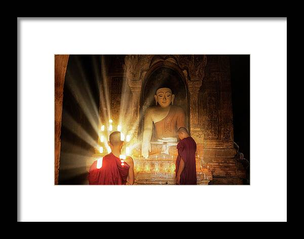 Asia Framed Print featuring the photograph Young Buddhist Monk Are Reading With Sun Light by Anek Suwannaphoom