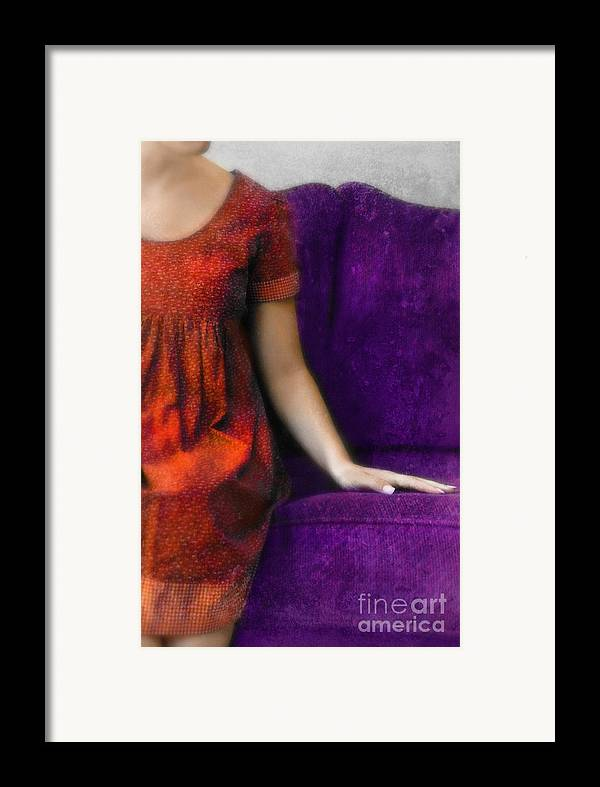 Woman Framed Print featuring the photograph Young Woman In Red On Purple Couch by Jill Battaglia