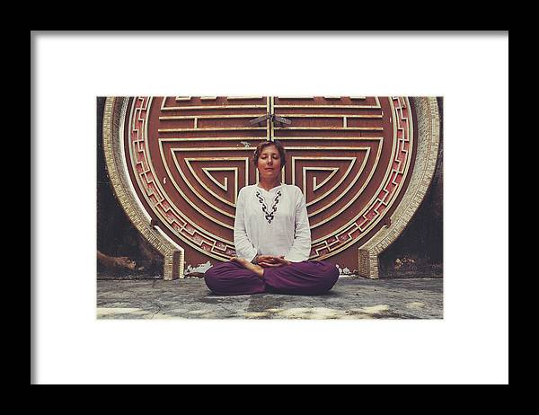 Balance Framed Print featuring the photograph Young Woman Sitting And Meditating In A Lotus Position In Front Of A Unique Doors by Srdjan Kirtic
