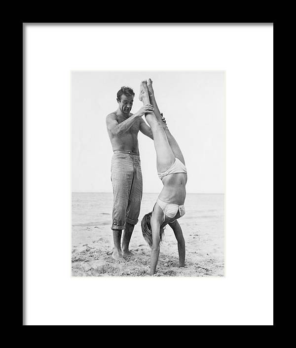Actor Framed Print featuring the photograph 007 Catches Ursula by Hulton Archive
