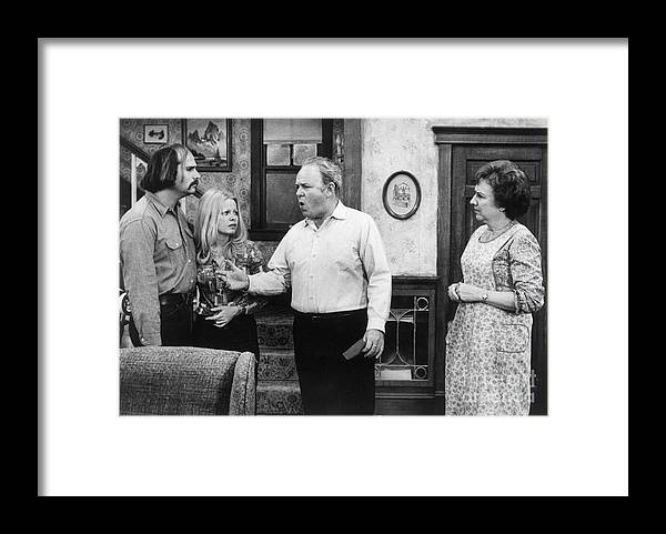 Mature Adult Framed Print featuring the photograph A Scene From All In The Family by Bettmann