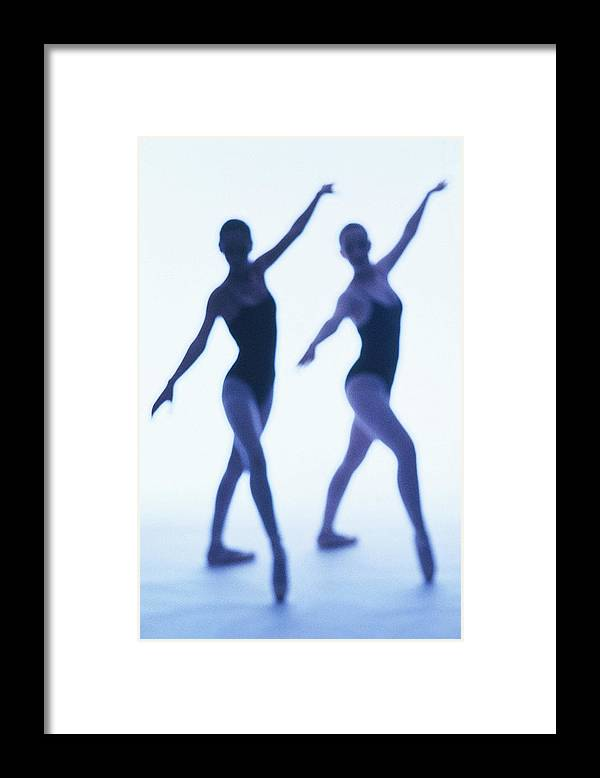Ballet Dancer Framed Print featuring the photograph A Silhouette Of Two Young Women by George Doyle