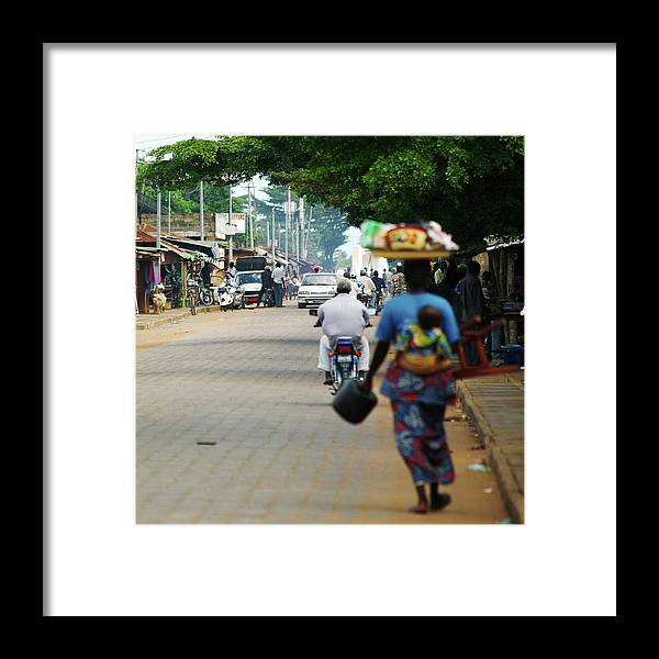 Trading Framed Print featuring the photograph African Street Scene by Peeterv