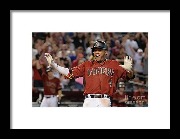 Three Quarter Length Framed Print featuring the photograph Atlanta Braves V Arizona Diamondbacks by Jennifer Stewart
