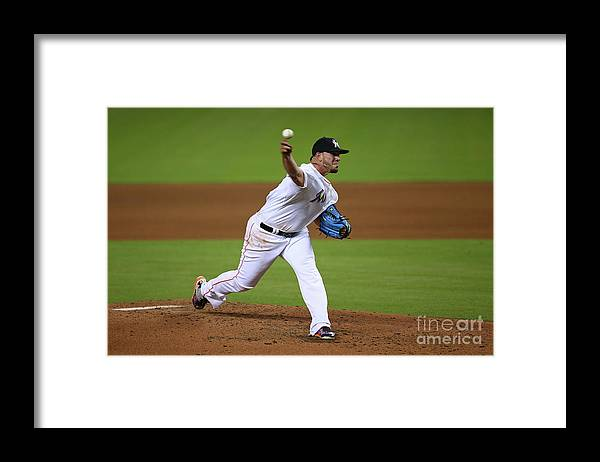 People Framed Print featuring the photograph Atlanta Braves V Miami Marlins by Rob Foldy